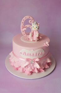princess themed birthday cake with ombre pink ruffle