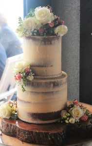 rustic naked style wedding cake with flowers