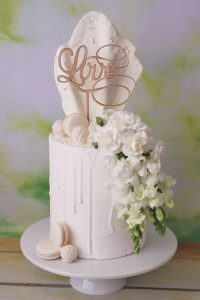 white on white drip style wedding cake