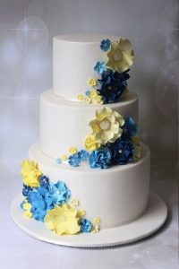 2 tier yellow and blue wedding cake