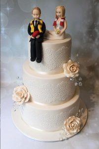 3 tier with handmade figurines AFL wedding cake